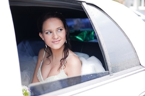Bride in a hired stretch limo