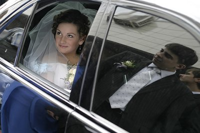 Bride inside hired Limo